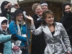 Former Alaska governor Sarah Palin waves to supporters after speaking at a rally Saturday in Madison, Wis.
