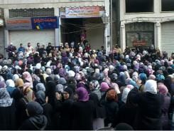 In this citizen journalism image, Syrian women attend an anti-government protest in Banias, Syria on Saturday.