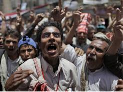 An anti-government protester reacts during a demonstration Saturday demanding the resignation of Yemeni President Ali Abdullah Saleh, in Sanaa, Yemen.