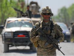 A U.S. Army soldier patrols near the village of Tarok Kolache on April 1 in the Arghandab River Valley of Afghanistan.