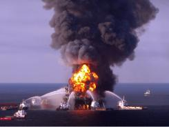 Crews respond to the blazing Deepwater Horizon oil rig  last April.