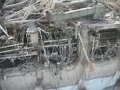 Fukushima Dai-ichi nuclear plant's Unit 3 shows damaged housing on Friday in Okuma, Fukushima Prefecture, Japan.