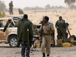 Libyan rebels fortify their position in Ajdabiya on Sunday as they regained control of the western gate of the town following a long day of heavy fighting.