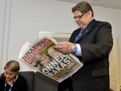 True Finns chairman Timo Soini reads a newspaper after his party soared from six to 39 seats Sunday.