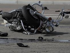 A motorcycle lies at the scene of a multi-motorcycle and trash truck accident on March 25, 2010, on the Carefree Highway in Phoenix.