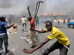 Protests erupted  in Nigeria's northern city of Kano as President Goodluck Jonathan won the national election.