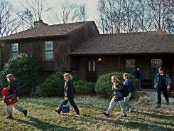 FBI investigators leave the house of spy Robert Hanssen in Vienna, Va., on Feb. 20, 2001. Hanssen, an FBI agent, was sentenced to prison for spying for Moscow since 1985.