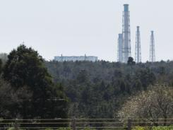 Part of Japan's Fukushima Dai-ichi nuclear power plant overlooks farmland in Futaba, Fukushima Prefecture.