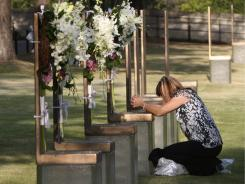 A retired police officer mourns on the 16th anniversary of the Oklahoma City bombing.