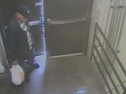 Image from surveillance video provided by the FBI shows person of interest sought in a fire and the planting of a pipe bomb and two propane tanks near a food court at the Southwest Plaza Mall in Littleton, Colo.