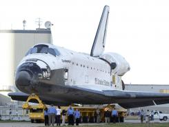 The space shuttle Endeavour is transported on Feb. 28 from the Orbital Processing Facility to the Vehicle Assembly Building where the orbiter will be connected to the external fuel tank and twin solid rocket boosters at the Kennedy Space Center in Cape Canaveral, Fla.
