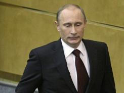 Russian Prime Minister Vladimir Putin walks to the lectern to address the State Duma in Moscow.