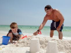 Dave Rutkowski and son Mason, 5, of Covington, Ky., are loving the beach at Okaloosa Island, Fla.
