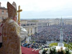 Pope Benedict XVI addresses the faithful during Easter Mass in St. Peter's Square last year.