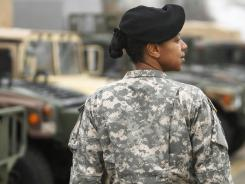 Army Maj. Sequana Robinson demonstrates a new women's combat uniform that is currently being evaluated by the Army.