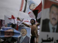 Yemeni President Ali Abdullah Saleh supporters rally in his support  in Sanaa on Friday.