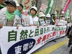 Farmers, many from the area near the crippled Fukushima Dai-ichi nuclear plant, protest in Tokyo.