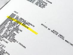 The name Barack Hussein Obama II is seen Tuesday highlighted in a computer generated birth index from 1960-1964 in a Hawaii state government binder held at the State Department of Health in Honolulu.