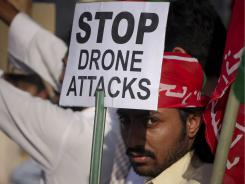 A supporter of Pakistan's Tehreek-e-Insaf, or Movement of Justice,  takes part in Saturday's rally against the U.S. drone strikes in Pakistani tribal areas in Peshawar, Pakistan.