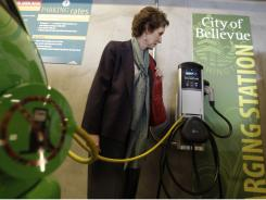 Martha Johnson,  of the U.S. General Services Administration, tours an electric vehicle charging station at Bellevue City Hall in Bellevue, Wash.