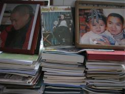 "Photos of Ran Yunfei stand in his study. Ran was charged with ""inciting subversion of state power."""