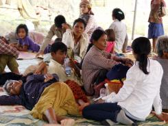 Displaced Cambodian villagers rest Saturday at a temporary shelter in Oddar Meanchey province, Cambodia.