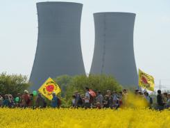 Anti-nuclear protesters march past the Grafenrheinfeld nuclear power plant near the southern German city of Bergrheinfeld on Monday.