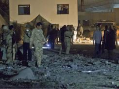 Airstrike on Moammar Gadhafi's sprawling residential compound early Monday badly damaged two buildings.