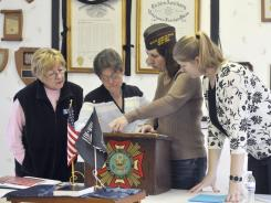 VFW members Judy Pollina, Beth Maddigan, Marlene Roll and Leonora Schreck prepare to start their meeting in West Seneca, N.Y. The post is the nation's only one catering to the needs of women.