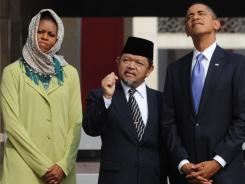 Visiting the most populous Muslim country: President Obama and first lady Michelle Obama tour a mosque in Jakarta, Indonesia with Imam Ali Mustafa Yaqub last fall.