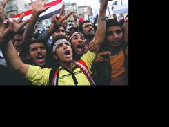 Activists chant slogans Tuesday in Yemen's capital, Sanaa, calling for the ouster of Yemeni President Ali Abdullah Saleh.