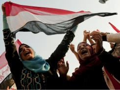 Celebrating freedom: Egyptians dance as they celebrate at Cairo's Tahrir Square.