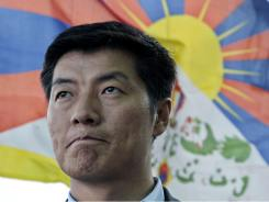 Legal expert Lobsang Sangay has won the election to become head of the Tibetan government-in-exile, taking over the Dalai Lama's political role.