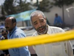 A Libyan man weeping outside Hikma hospital in Misrata on Wednesday.