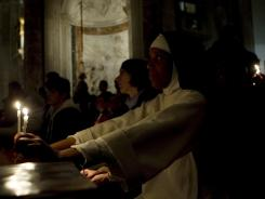People pray early Sunday in the Church of St. Anese in Agone in Rome. They prepared for the beatification of Pope John Paul II.