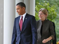 President Obama and Elizabeth Warren, who's setting up the Consumer Financial Protection Bureau.