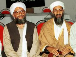In this 1998 file photo, Ayman al-Zawahri, left, poses for a photograph with Osama bin Laden, right, in Khost, Afghanistan.
