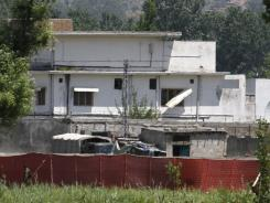 Pakistani soldier stands near a compound Monday where it is believed al-Qaeda leader Osama bin Laden lived in Abbottabad, Pakistan.