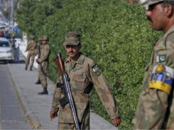 Pakistan army soldiers stand guard near the compound where it is believed al-Qaeda leader Osama bin Laden lived in Abbottabad, Pakistan, on Monday.