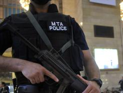An armed Metropolitan Transportation Authority police officer stands guard in New York's Grand Central Station on  Monday. Security was heightened after Osama Bin Laden was reported dead by President Obama.