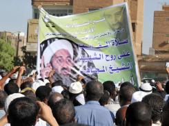Memorial: Sudanese sympathizers gather Tuesday in Khartoum to honor Osama bin Laden, the al-Qaeda leader shot dead in Pakistan Sunday.