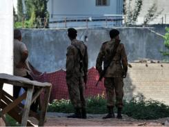 Pakistani soldiers keep guard in front of Osama bin Laden's compound following his death by U.S. Special Forces.