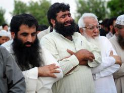 Members of Jamaat-ud-Dawa, which has ties to terrorist group Lashkar-e-Taiba, pray Tuesday for Osama bin Laden in Karachi, Pakistan.