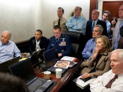President Obama and Vice President Biden, along with members of the national security team, receive an update on the mission against Osama bin Laden in the Situation Room of the White House on Sunday.