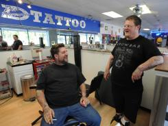 """Gentleman"" Jim Birkbeck, left, and Keith Maynard, both tattoo artists at Blue Horseshoe Tattoo, talk about local reaction to Navy SEALs killing Osama bin Laden."