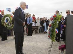 Then-GOP presidential candidate Sen. John McCain, R-Ariz., pauses after placing a wreath at the temporary United Flight 93 memorial in Shanksville, Pa., on Sept. 11, 2008.