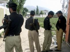 Pakistani police officers block a street to the compound of Osama bin Laden in Abbottabad on Wednesday.