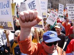 Union members rally last April at the Michigan Capitol in Lansing, protesting GOP Gov. Rick Snyder's proposed cuts.
