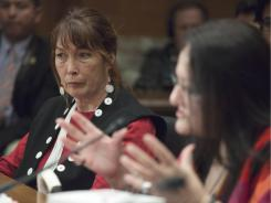 Charlene Teters, professor at the Institute of American Indian Arts in Santa Fe, left, listens as Suzan Shown Harjo, president of the Morning Star Institute, testifies Thursday in Washington before the Senate Indian Affairs Committee.