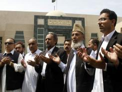 Supporters of Pakistan's Islamic Lawyer Forum pray Wednesday for  Osama bin Laden outside the Peshawar High Court building in Peshawar, Pakistan.